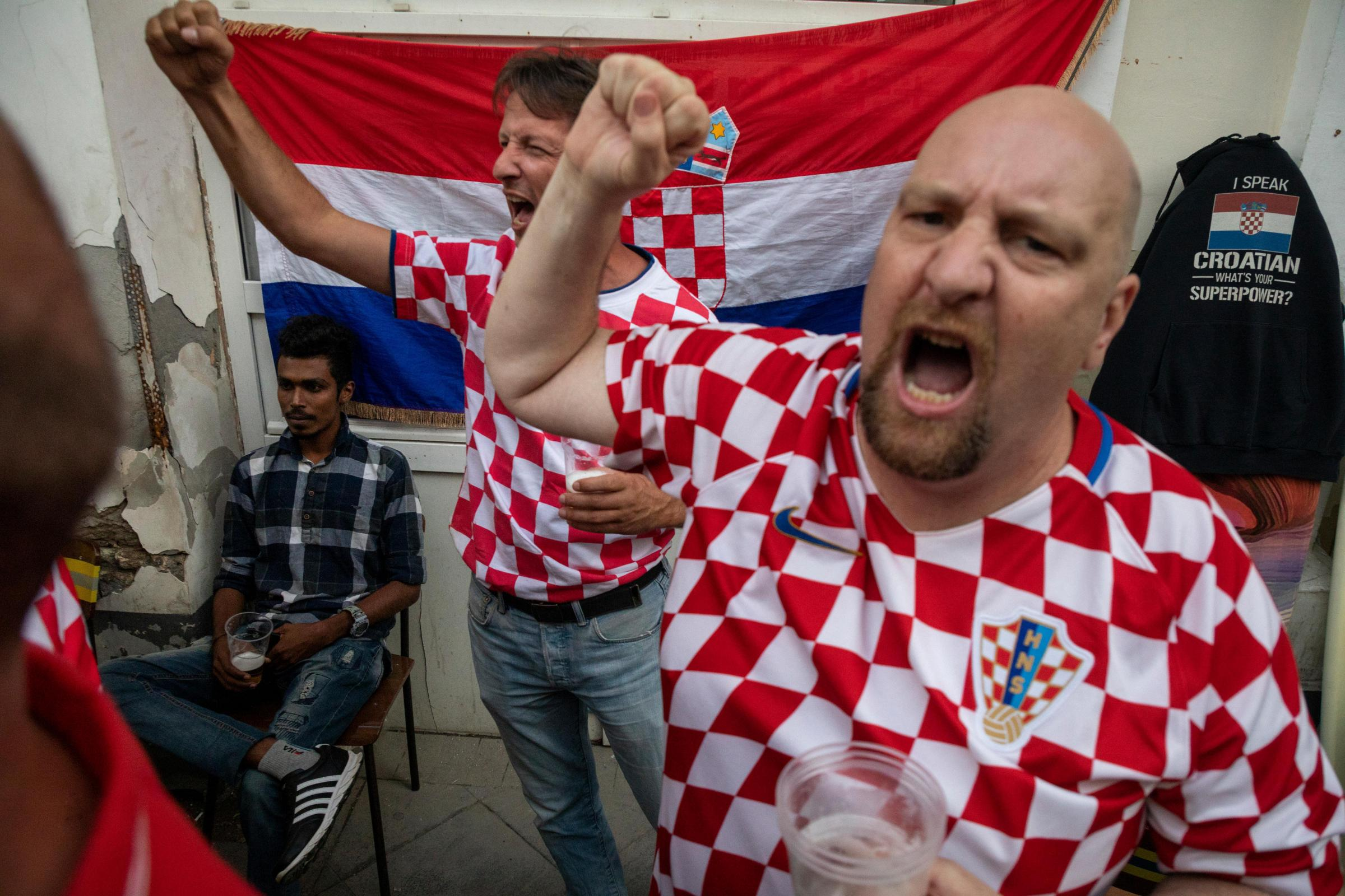 Croatian football fans cheer before the England game