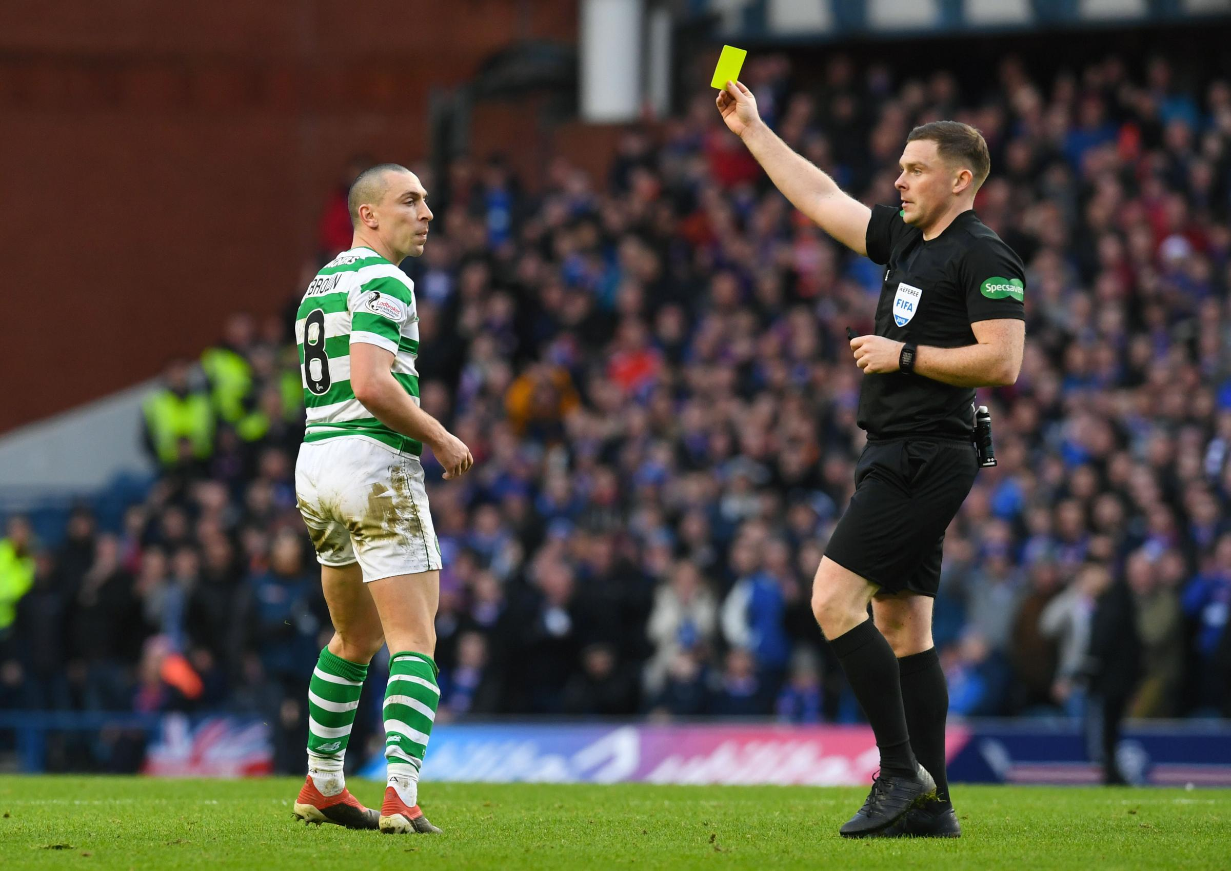 Celtic's Scott Brown is booked by referee John Beaton