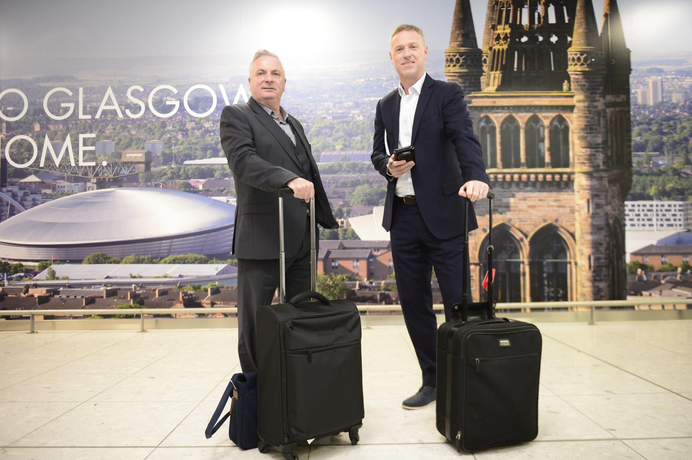 Football agents John Viola (left) and Craig Moore (right) at Glasgow Airport
