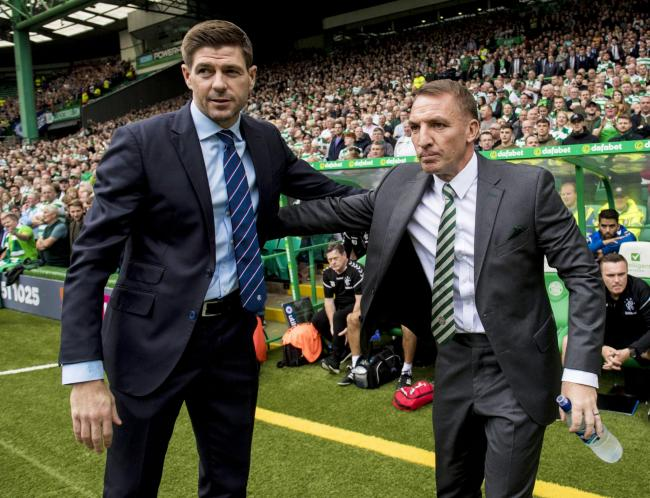 Rangers manager Steven Gerrard (left) shakes hands with Brendan Rodgers