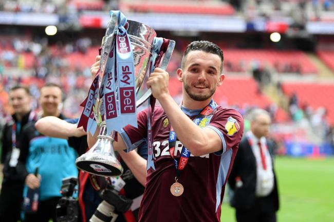 John McGinn of Aston Villa celebrates with the trophy
